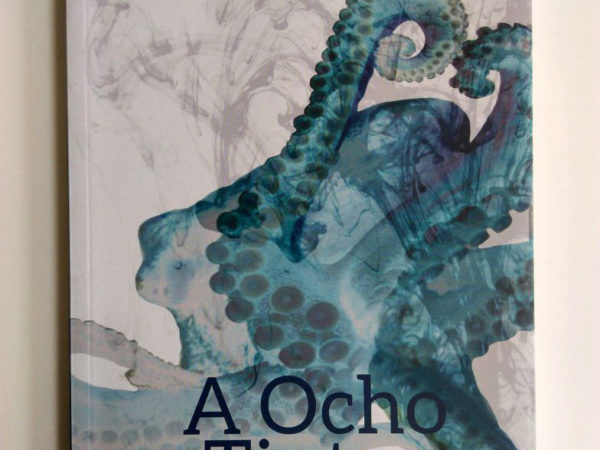 <span>A Ocho Tintas</span><i>→</i>